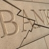 Moody's cuts ratings on 16 Spanish banks