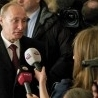 Tears and promises as Putin claims victory