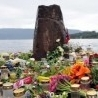Flowers and candles for the dead on Utoeya island
